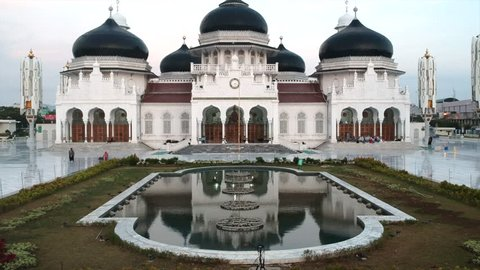 a 4k aerial footage of Baiturrahman Grand Mosque in Acheh, Indonesia. The mosque is a landmark of Banda Aceh and has survived the 2004 Indian Ocean tsunami.