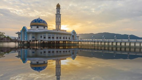 Time lapse of sunset and scattered clouds at Masjid 1000 Selawat Mosque with reflections in Pangkor Island, Perak, Malaysia. Zoom in motion timelapse. Prores Full HD 1080p.