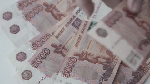 Rouble. Money. Bill 5000. Counting money.