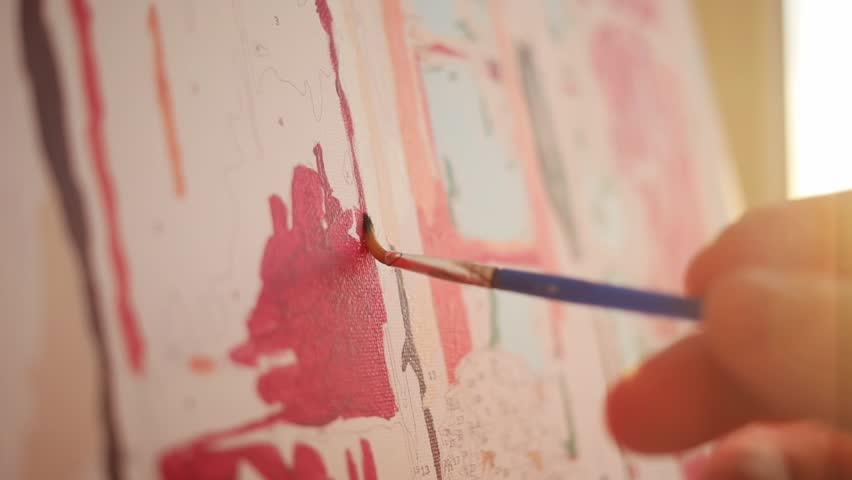 Close up artist hand hold brush painting picture on canvas in art studio sunset artists studio creativity drawing design girl pattern ornament sun art colourful paper fine art color slow motion | Shutterstock HD Video #1015575187