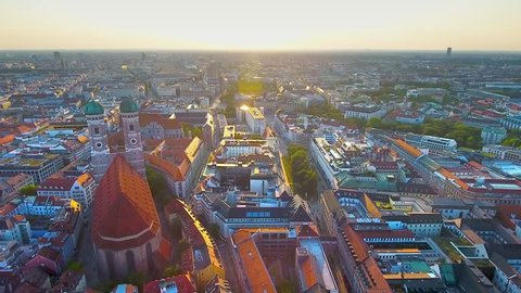 Munich aerial view at sunrise flying over Munich Marienplatz old town view of Frauenkirche (Cathedral of Our Dear Lady) beautiful birds view of Munchen City Bavaria Germany.