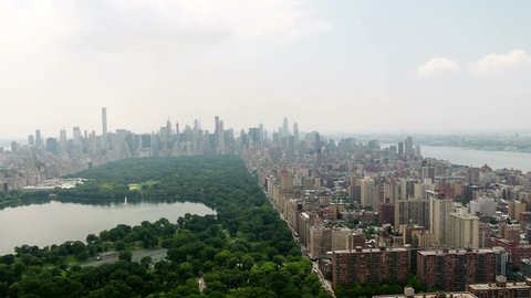 Central Park rising over green and buildings aerial New York City NYC 4K and 1080 HD