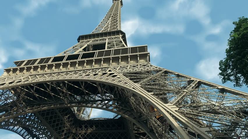 A hyper timelapse of the Eiffel Tower along the river Seine | Shutterstock HD Video #1015652257