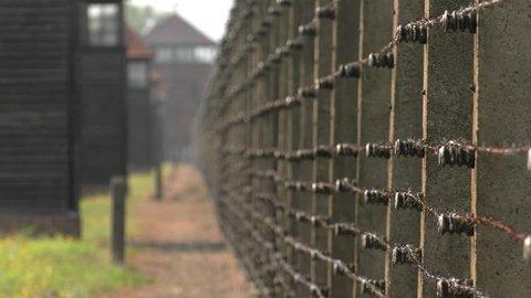Auschwitz, Oswiecim Poland, June 2018: Guard Tower Auschwitz-Birkenau Concentration Camp, War Memorial. 4K, UHD, 50p, Cinematic,Panning,