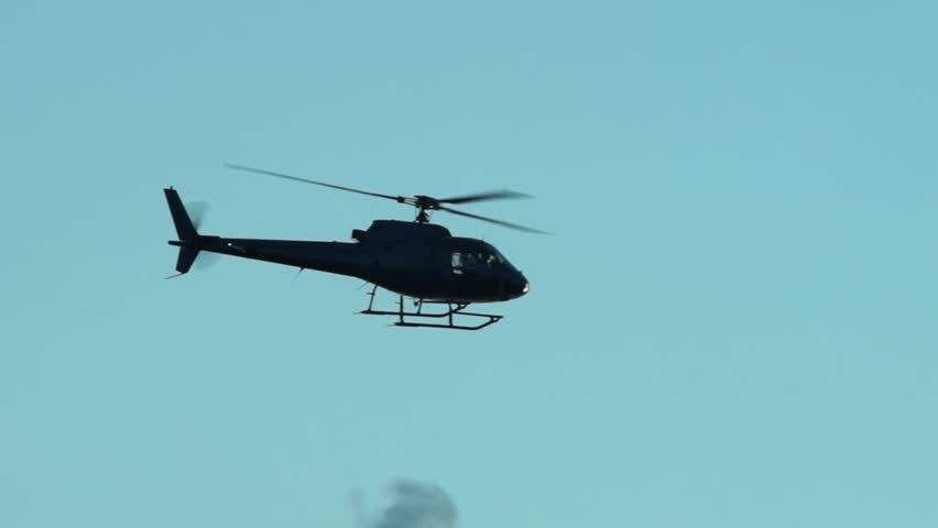 Helicopter flying in the sky at dusk