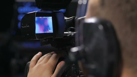 Camera operator working with a cinema broadcast TV camera