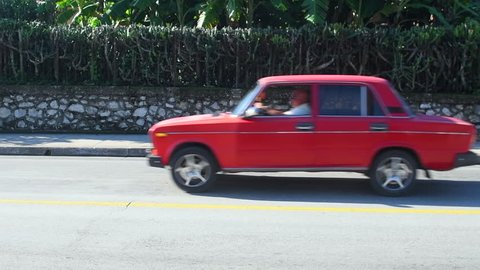 Santa Clara, Cuba-July 20, 2018: Slow motion of a red Russian Lada car. Cuba is known for the large diversity of cars from different epoch