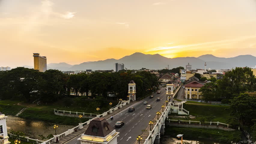 Timelapse : Ipoh Main Bridge from aerial view during beautiful sunset.