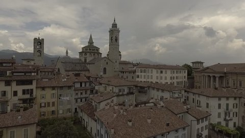 Aerial drone footage view OF Bergamo, historical buildings and towers  of Old city, in Italy // no video editing