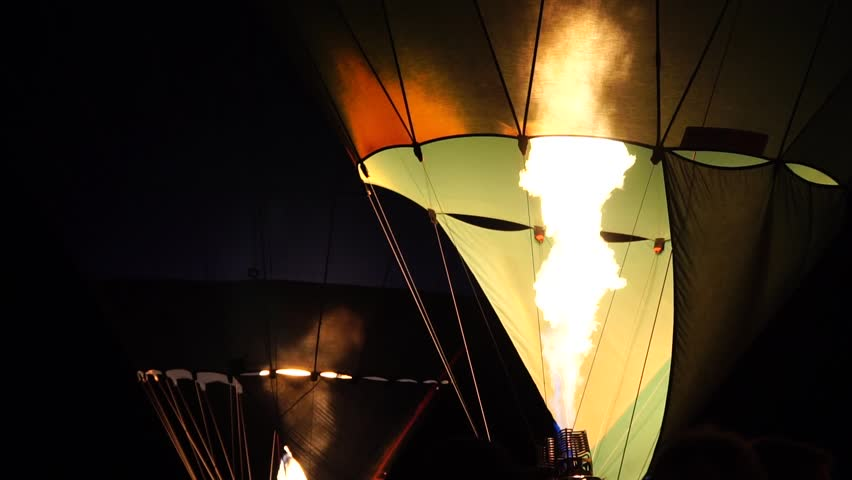 Night-Glow Background. Beautiful Fire And Hot Air Balloon Ride. Dark Night And Colorful Ballooning Festival In Warstein, Germany. | Shutterstock HD Video #1015809217