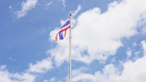Thai national flag on blue sky background,National flag of Thailand.