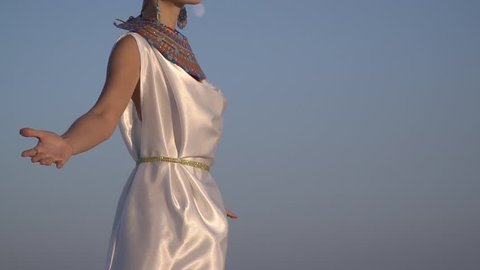 Slow-motion shooting, Pharaoh's wife in traditional clothes meets the dawn