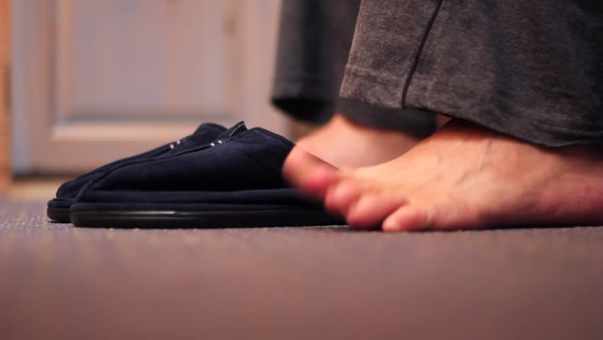 Close Up of Mans Feet Sliding Into Slippers before Walking Away