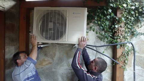 BANSKO, BULGARIA - 27 DEC, 2016: Iinstallation of the air conditioner outdoor unit in hotel appartment