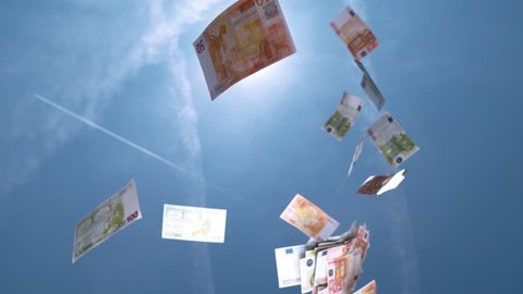 SLOW MOTION, CLOSE UP: € Money falling from the sky. Fifty and hundred euro bills falling from blue skies. Successful business bringing piles of money. Profitable job and big salary. Winning lottery