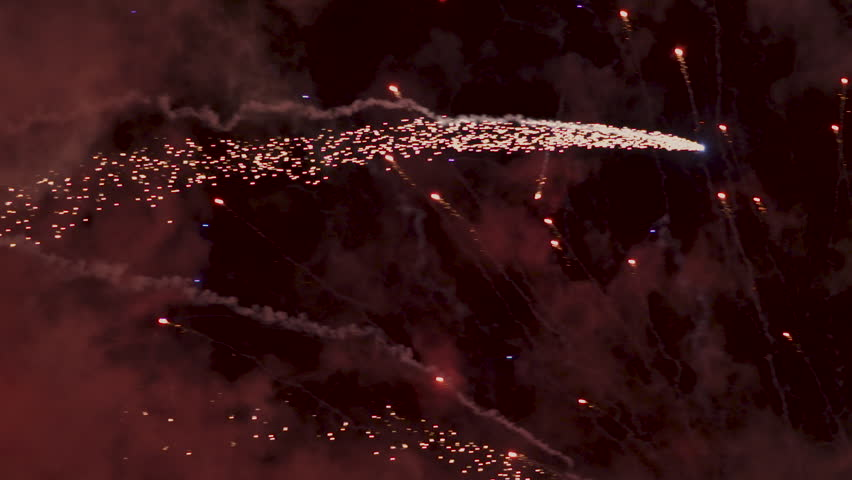Slow motion footage of fireworks exploding in the sky on NYE. 200fps.