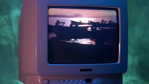 MONTREAL, CANADA - September 2018 : The popular TV show in the 90's Baywatch on a tube vintage TV. Zooming out with fog giving a retro look at the scene.
