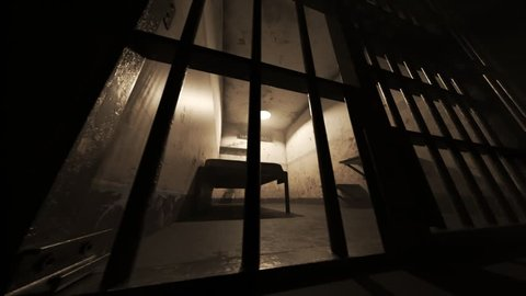 Animation of an old grunge locked prison cell seen through jail bars. Floor camera