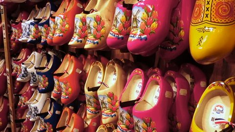 ZAANSE SCHANS, NETHERLANDS - APRIL 11, 2018: Dutch traditional wooden shoes, clogs, symbol of Netherlands for sale at the souvenir shop