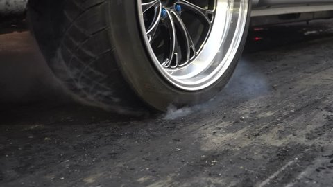 Drag racing car burn tire at start line