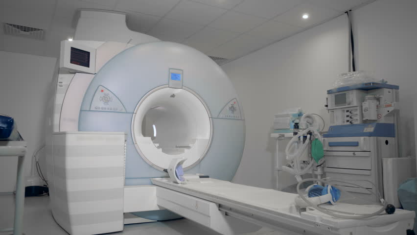 MRI scanning machine located in a medical facility #1015996087