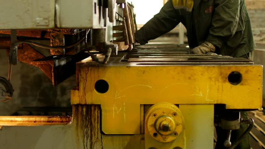 The worker is engaged in cutting of metal on the production automatic machine tool, metal cutting,manufacturing | Shutterstock HD Video #1016024167