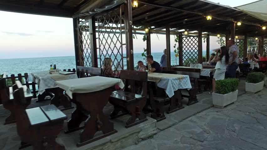 NESEBAR, BULGARIA - 11 AUGUST, 2016:  Restaurant in old town of Nessebar, Bulgaria. Ancient city of Nessebar is a UNESCO world heritage site. Tourist pov