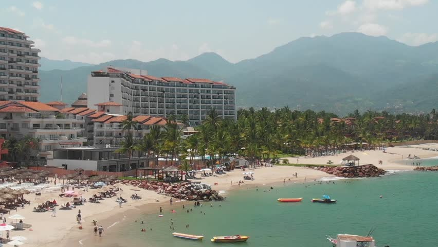 Aerial dolly zoom with panoramic view of Bahía de Banderas in Puerto Vallarta, México on a clear and sunny day.   Shutterstock HD Video #1016083057