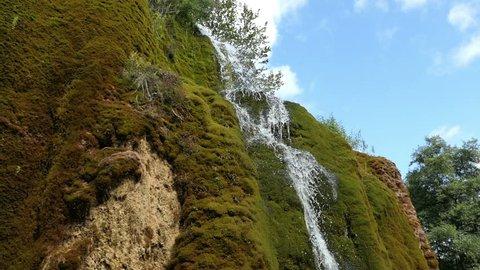 Travertine waterfall Dreinmuehlen (engl. three mills) at Nohn in  Vulcan Eifel region (Germany)