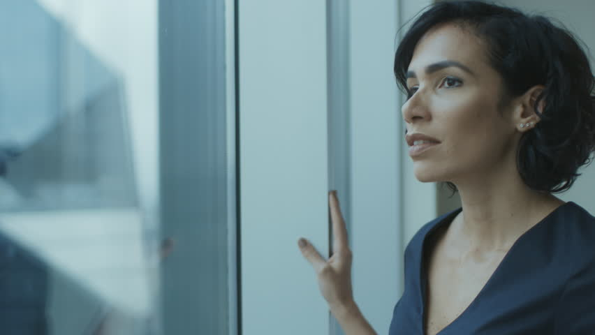 Portrait of the Beautiful Young Businesswoman Looking Thoughtfully out of Her Office Window.    Shutterstock HD Video #1016145877