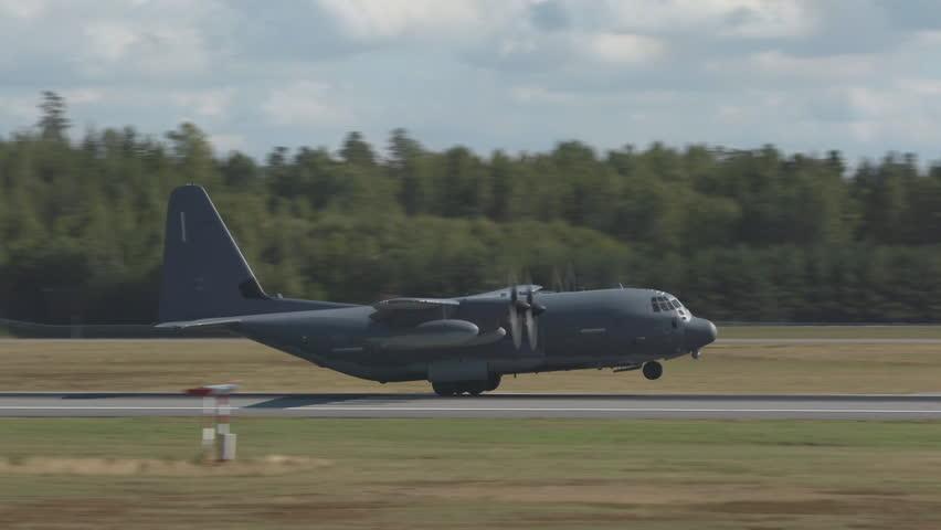 Oslo Airport Norway - ca September 2018: military usaf airplane c130 hercules landing runway slow motion