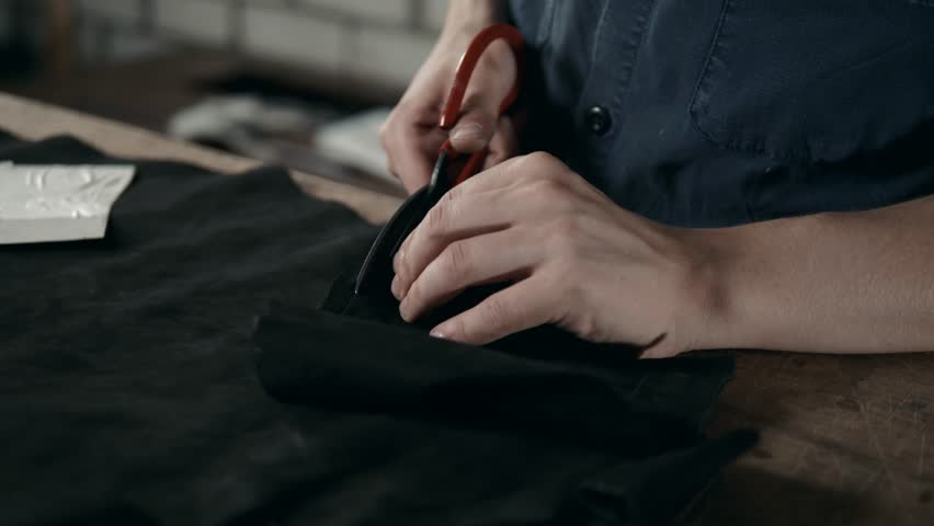 Man working with leather, shoemaker designer fashion work with shoes boots close up scissors factory handmade