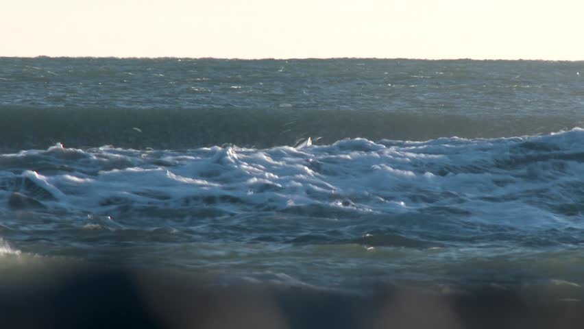 Giant stormy ocean crashing waves in different layers breaking splashing by wind #1016241277