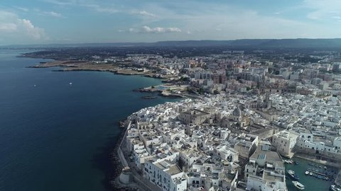 Aerial video. Old Town of Monopoli - city on Adriatic Sea. Italy. 4K