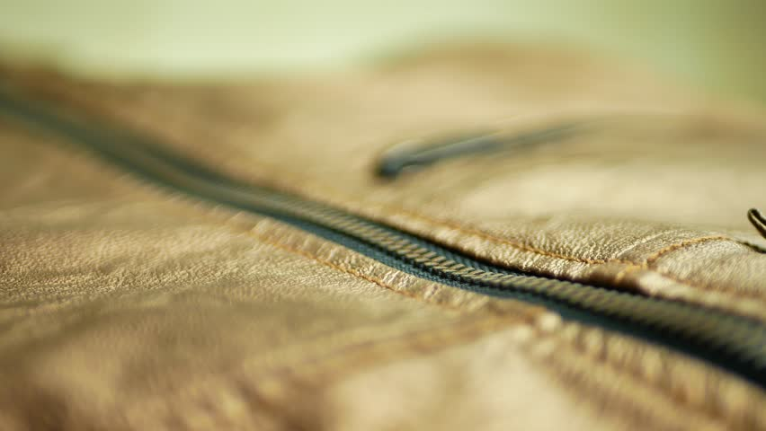 Unzipped brown golden leather jacket