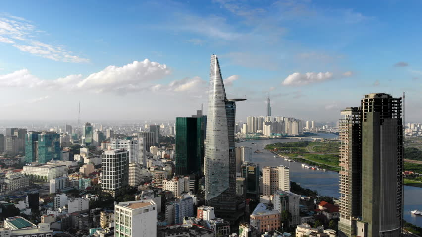 Aerial view of Downtown district of Ho Chi Minh City, aka Saigon, including architectural landmark Bitexco Financial Tower during daytime, South Vietnam. | Shutterstock HD Video #1016314237
