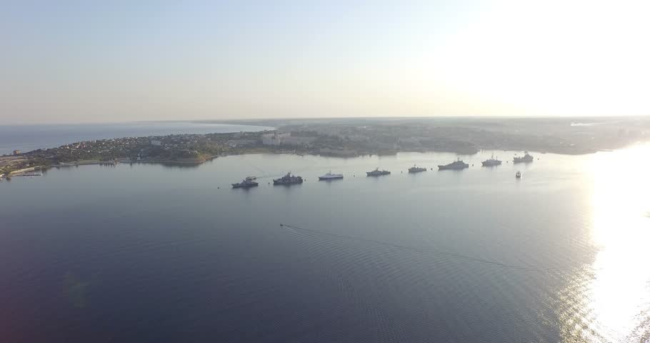Shooting from the air of  Sevastopol bay, warships in the roads, Russian Navy Day 2015 | Shutterstock HD Video #1016330437
