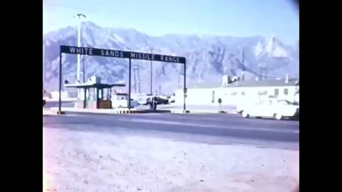 CIRCA 1960s - A truck carrying a Little Joe II rocket is driven through a gate at White Sands Missile Range.