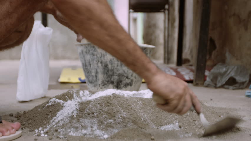 Man Mixing Cement in Street | Shutterstock HD Video #1016355397