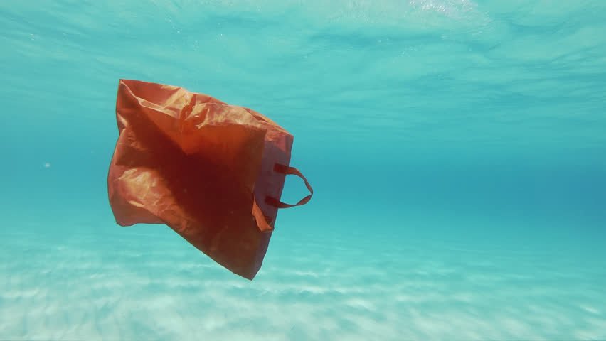 Plastic Pollution Underwater. Red Plastic Shopping Bag Floating Underwater In The Mediterranean Sea | Shutterstock HD Video #1016406277