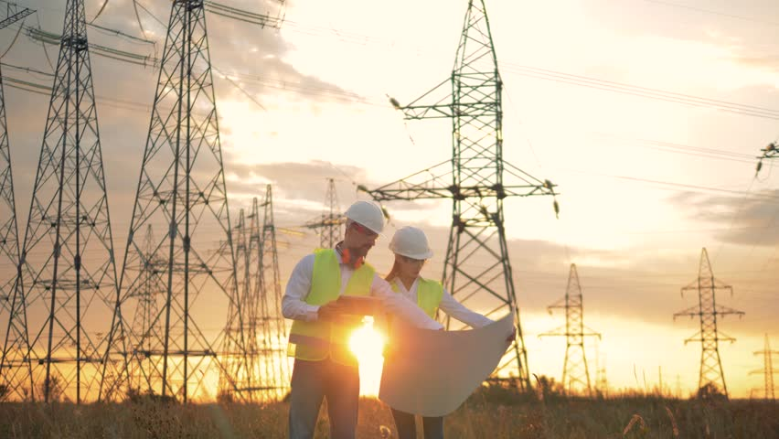 Woman and man work with scheme on a sunset background.