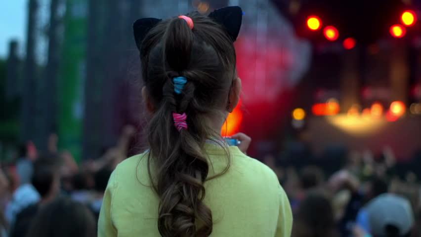 Fan kid on father shoulders enjoy listening to concert   Shutterstock HD Video #1016461657