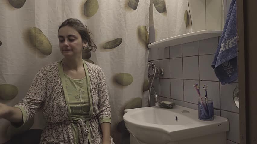 Woman rinsing the throat