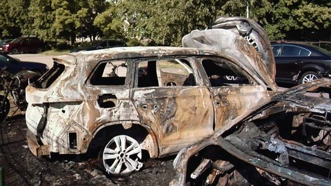 The Car After the Fire. Burnt Out Car With an Open Hood. Engine Burned Out Car Wreck After a Fire. Vandalism.