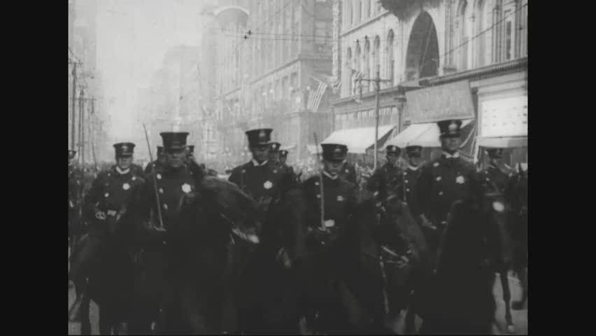 CIRCA 1920s - Marshal Ferdinand Foch is driven in a parade and he receives a degree at the University of St. Louis and he watches a parade.