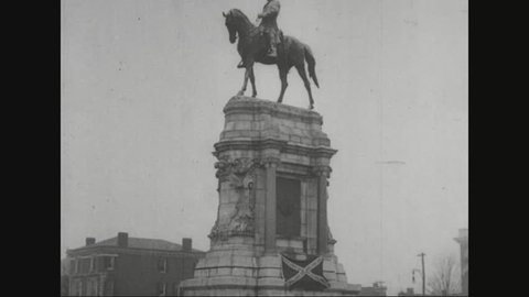 CIRCA 1920s - Marshal Ferdinand Foch places a wreath at a monument and visits a battle reenactment in Richmond, Virginia.