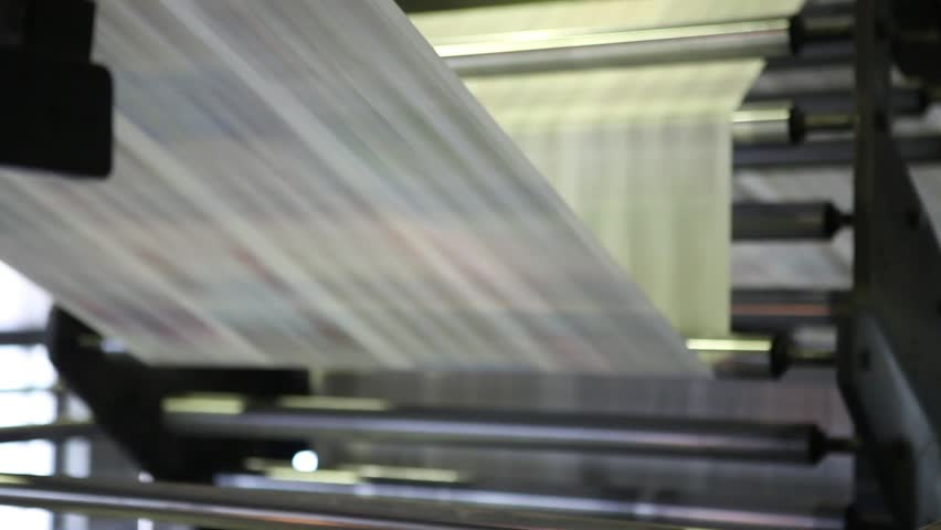 Video clip from the printing factory. Kilometers of newspapers. Printing machines in operation.