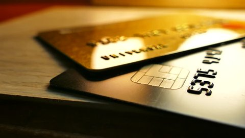 Money in bank accounts. Credit bank cards are on the table. Cashless payments.