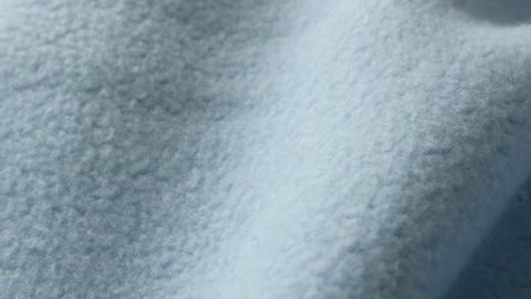 Close-up of blue blanket made of finest polar fleece 4K panning video