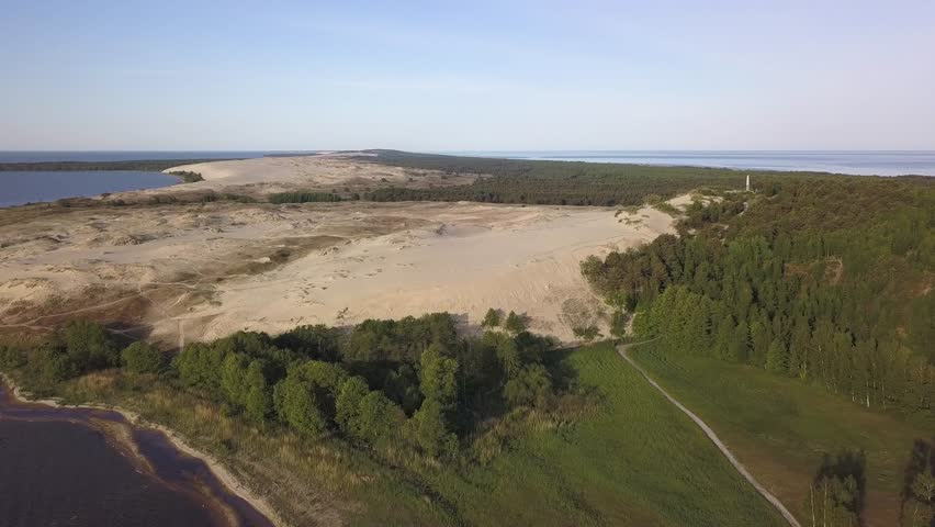 Early morning aerial view of Parnidzio dune meeting sea in Curonian spit near Nida, Lithuania   Shutterstock HD Video #1016633647